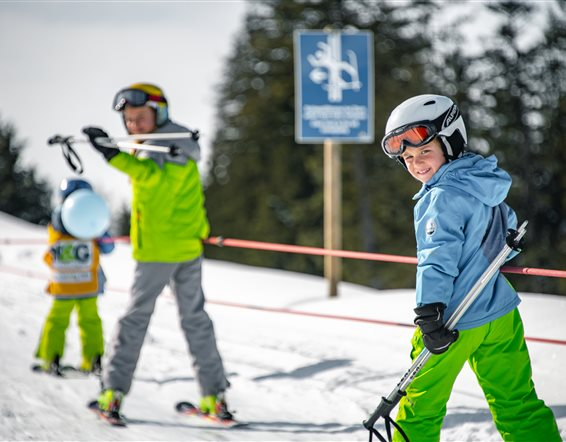 Children ski in the drag lift