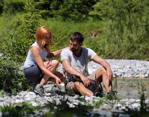 Couple is resting on a stream