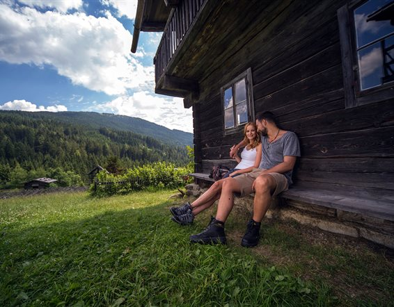 Couple rests at mountain hut