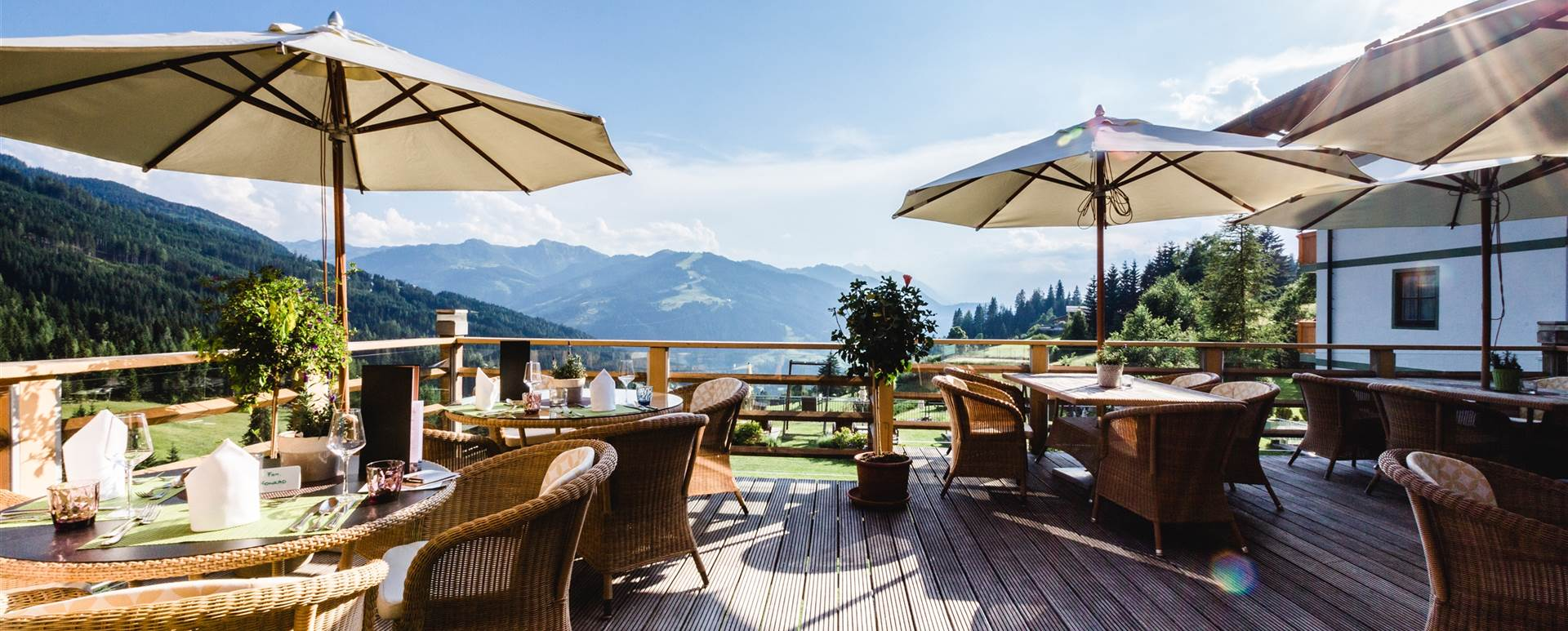 Hotel Edelweiss terrace with tables and chairs